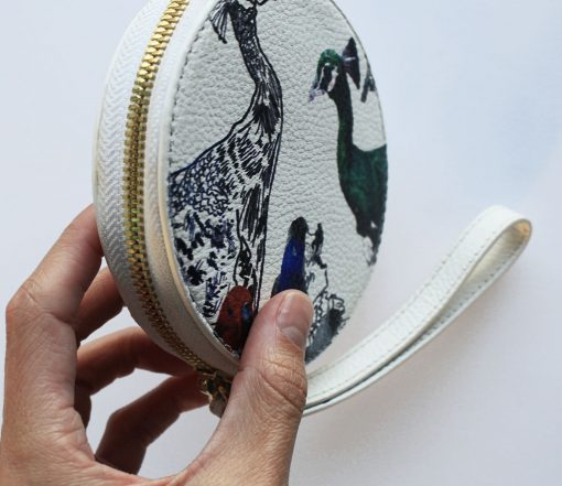 White leather purse with bird print for women.