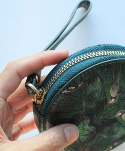 Green bird print leather purse for women.