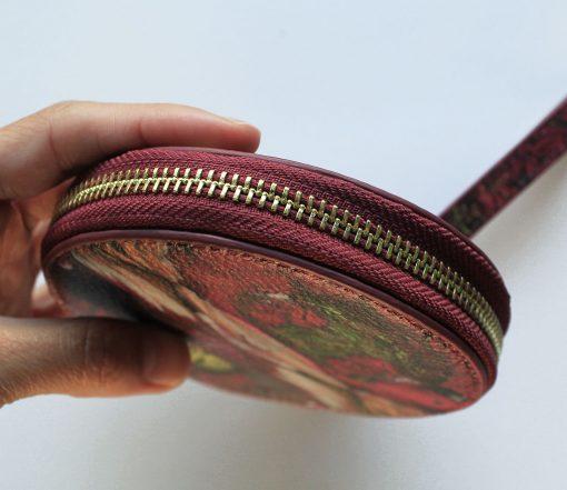 Magenta bird print leather purse for women.