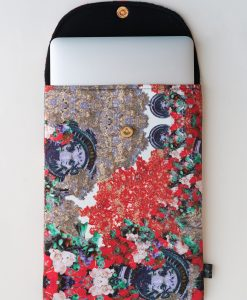 Floral laptop sleeve in red, lilac and mint green.