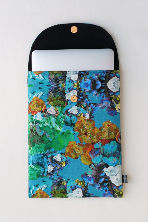 Floral laptop sleeve in blue, orange and white.