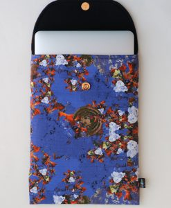 Floral laptop sleeve in purple and orange.