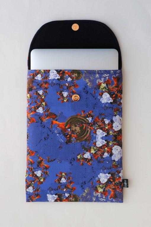 Floral laptop sleeve in purple and orange.