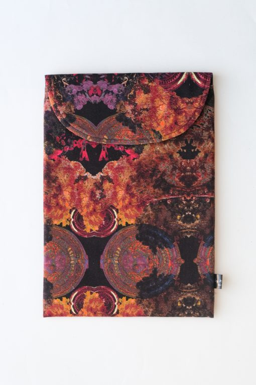 Floral laptop sleeve in black, purple and orange.