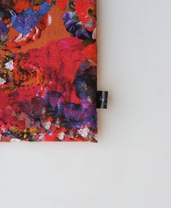 Floral laptop sleeve in pinks and oranges.