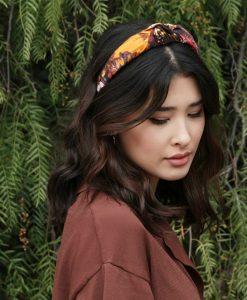 Orange and dark coloured silk hairband